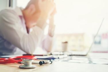 Doctor-Burnout-iStock-Sarinyapinngam_865228192.jpg